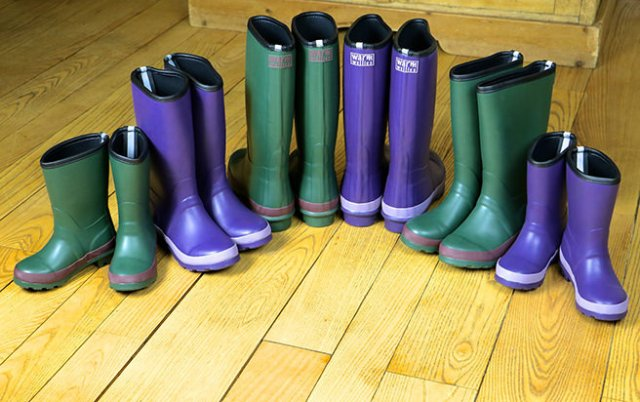 Line up of kids' Wellington boots from The Warm Welly Co.