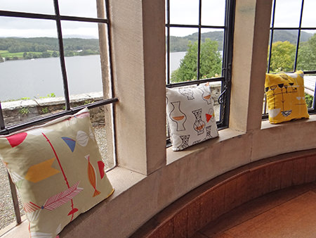 Cushions covered in relaunched David Whitehead fabrics in bay window of Broad Leys, home to the Windermere Motor Boat Racing Club