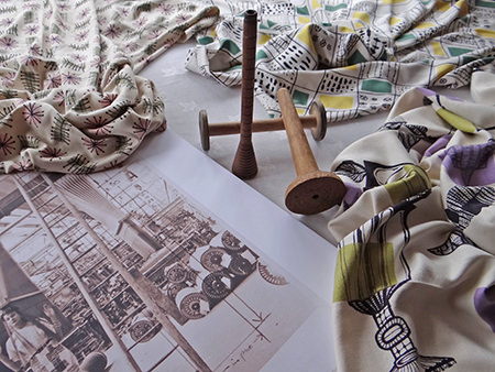 Samples of original vintage David Whitehead fabrics with antique wooden bobbins and page from a vintage Ambassador magazine fashion shoot featuring Whitehead fabrics