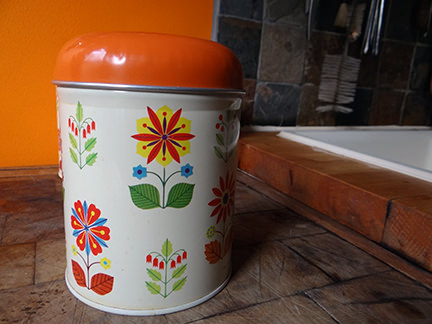 single vintage storage tin with floral pattern
