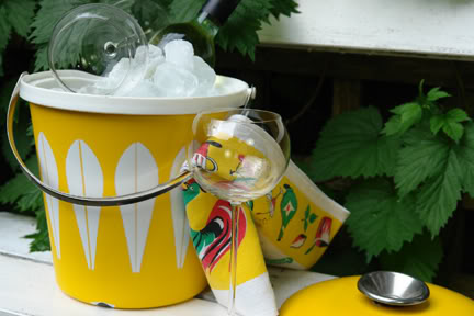 Vintage yellow & white Ice-filled Cathrineholm 'Lotus' pattern ice bucket with pair of wine glasses and tea towel