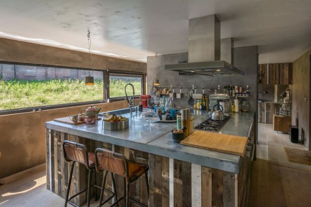 Industrial kitchen in a floating house in Utrecht