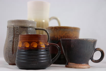 group of hand thrown pottery mugs