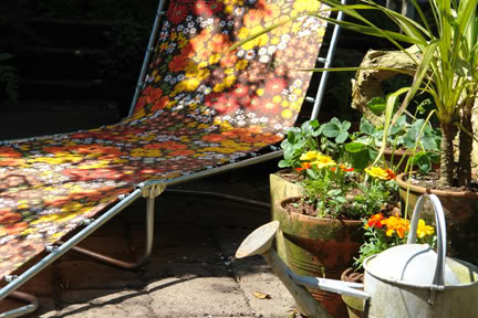 photo of our garden with vintage floral sun lounger