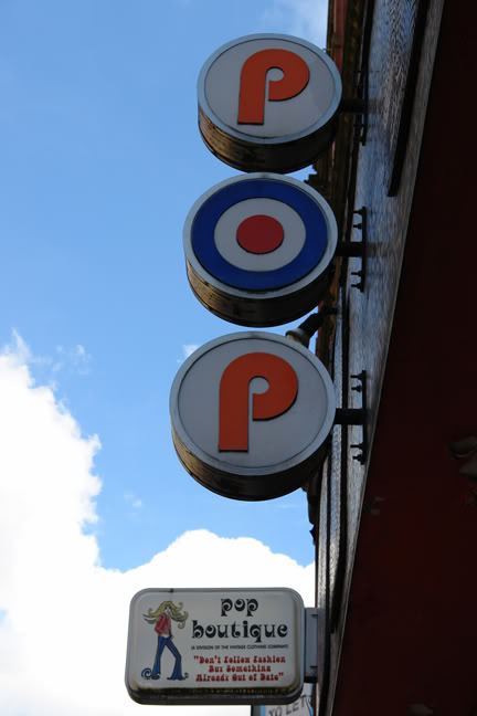 Sign on the outside of Pop Boutique, Manchester