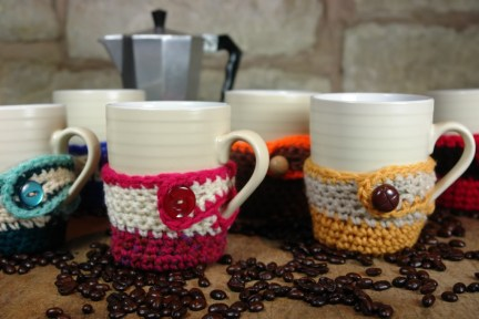 collection of hand knitted mug cosies