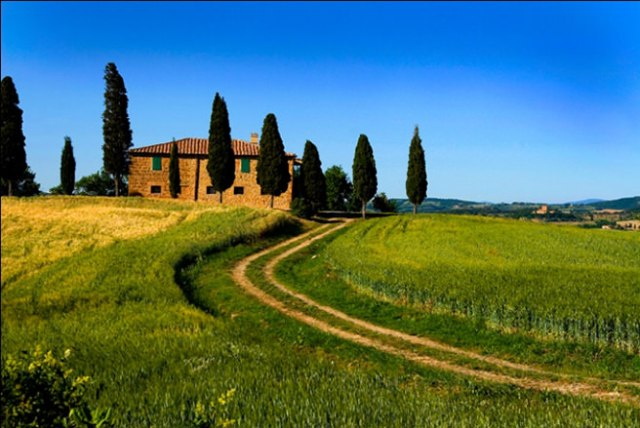 Tuscan villa against a bright blue cloudless sky
