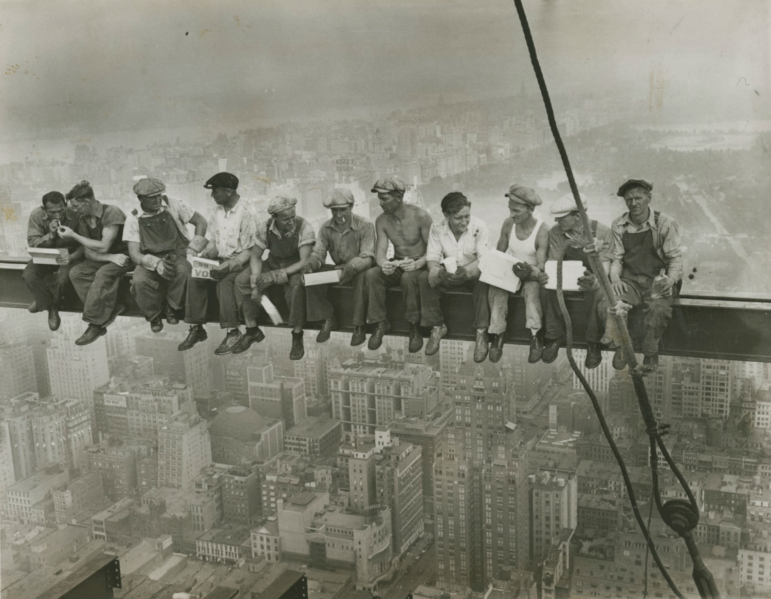 Charles C. Ebbets, Lunchtime Atop the World's Largest Building, Rockefeller Center, New York, 1932. Courtesy of Howard Greenberg Collection