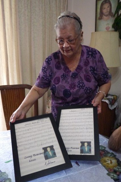 Auntie Shirley - Mrs Soliano - showing off a couple of Mr Soliano's original scores.