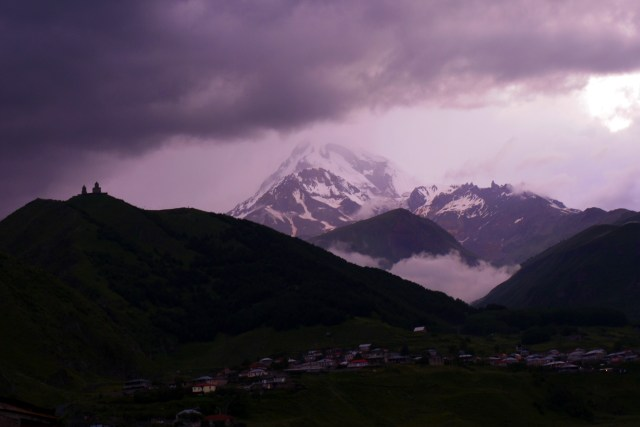 Mount Kazbegi with Gergeti Trinity Church on the left - Kazbegi District, Georgia