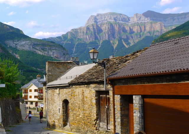 The medieval old town of Torla with mountains rising up in the background - Torla, Spain