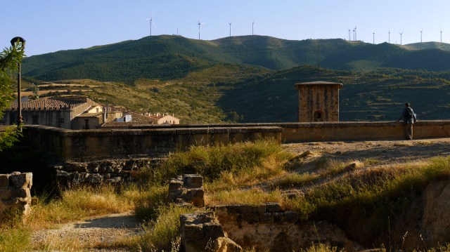 On the summit of St. Stephan's Church, with wind turbine topped hills in the background - Sos del Rey Catolico, Spain