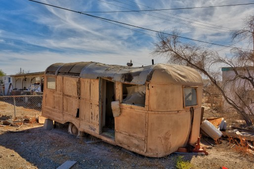 "An old ""Airstream-like"" trailer that has seen better days."
