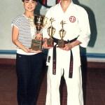 "梁伯偉師傅勇奪個人搏擊冠軍、套拳亞軍和比賽最高榮譽之 『冠軍之皇』;旁為吳冰姸小姐 ensei Patrick P. W. Leung won the champion in individual kumite, 1st runner-up in individual kata; he was also the champion in the category ""Champion of the Champions"" - the highest title in the overall kumite categories; beside Sensei Patrick P. W. Leung was Ms. Venus B. Y. Ng"