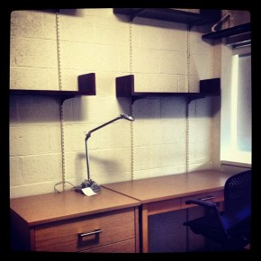The mock up dorm room includes new furniture, carpeting, paint, and lighting.