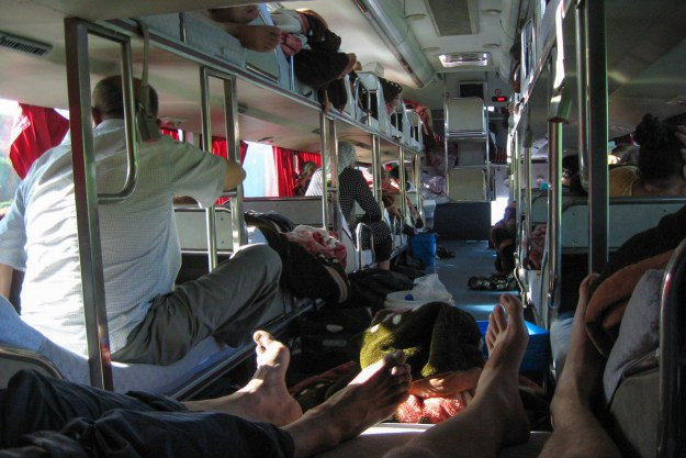 My and Eric's feet and the sleeper bus to Urumqi