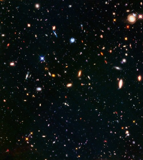 "This part of the sky was observed in parallel with the galaxy cluster Abell S1063 and is also part of the Frontier Fields programme. While one of Hubble's cameras observed the galaxy cluster itself, another simultaneously captured the spectacular scene pictured above, of an ""unremarkable"" patch of space. While not having the advantage of strong gravitational lensing this parallel field observation is still nearly as deep as the Hubble Ultra-Deep Field. Combined with other deep fields it helps astronomers understand how similar the Universe looks in different directions."