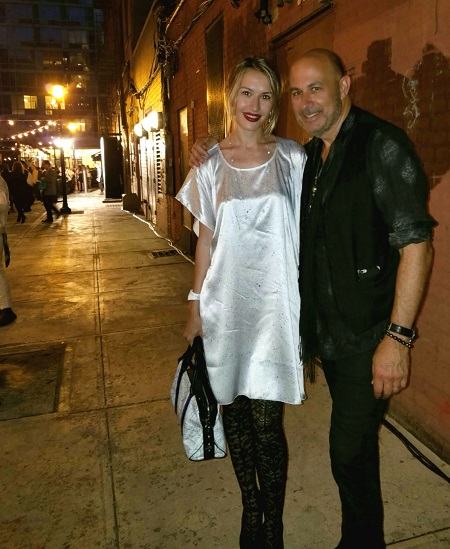 Model Irina Proskurina with designer John Varvatos