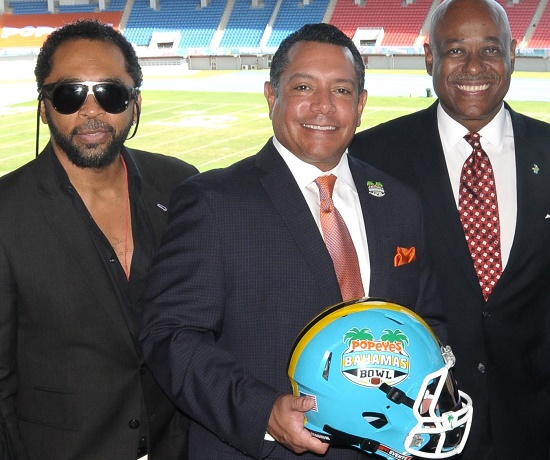 HOMBRE Magazine's Francisco Romeo, Popeyes Chief Marketing Officer of U.S. operations and Vice President Hector Muñoz and Bahamas Minister of Tourism Obie Wilchcombe