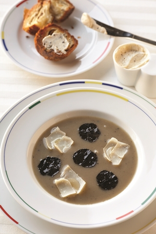 One of RESTAURANT GUY SAVOY'S signature dishes, the artichoke and black truffle soup was once named one of the top 10 dishes in the world. The exquisite dish arrives at the table topped with shaved black truffle and parmesan cheese and accompanied with a toasted mushroom brioche slathered with truffle butter.