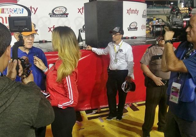 The HOMBRE team interviews winning team owner Joe Gibbs