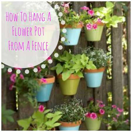 Hanging your flower pots from the fence home and garden - Flower pots to hang on fence ...