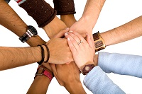 team with arms together in cooperation to look for success - isolated over a white background