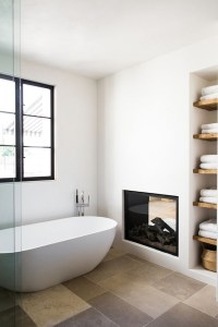 cozy-bathroom-fireplaces-with-wall-shelving