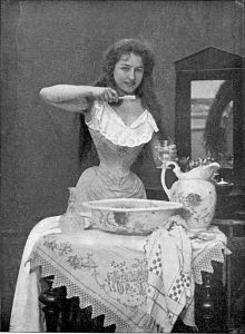 old photo of woman with small waist brushing her teeth