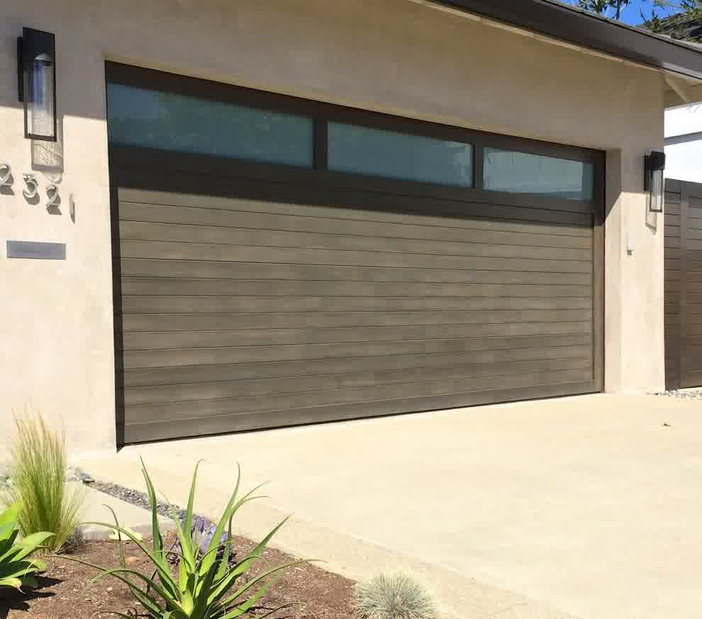 Double cars mid century modern garage doors with wood material and windows on top plus wall