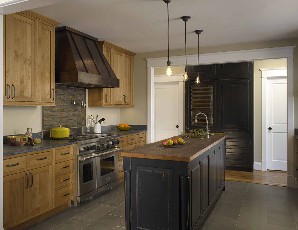 kitchen remodeling northern virginia with wooden cabinets and kitchen island and pendant lamps and sink plus granite countertop and tile floor
