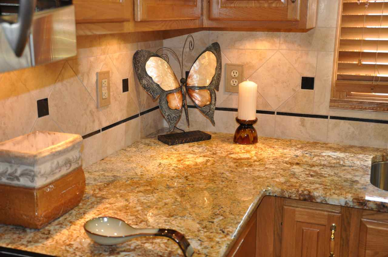 Granite Countertop Shapes Kitchen With River Gold Granite Luxurious Accent Homesfeed