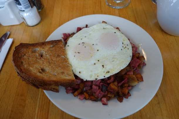 Corned beef hash served with eggs
