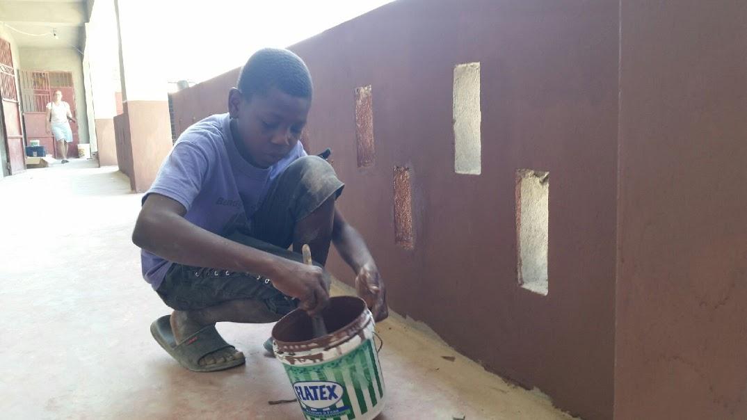 Nobel helping paint school