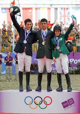 Bronze medalist Dalma Rushdi Malhas, at right, on the podium for individual jumping at the Youth Olympic Games in 2010. Individual gold medalist Marcelo Chirico takes centre stage on the podium, with silver medalist Mario Gamboa at left.
