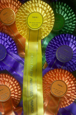 The THINK head injury awareness rosettes.