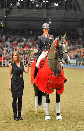 Charlotte Dujardin riding Valegro, winner of the Reem Acra FEI World Cup Grand Prix Freestyle is presented with the trophy by Heather Schmidt.