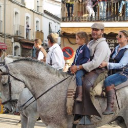 Family on horseback.
