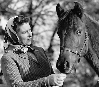 The Queen with a foal at Sandringham in 1964.
