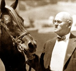 W.K. Kellogg with one of his arabians in 1928.
