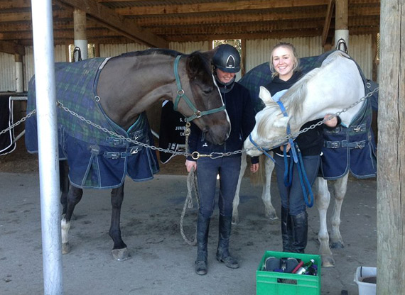 Tegan Fitzsimon and Anna Thomas with horses at the Fitzsimon barn on Sunday, two days before the fire.