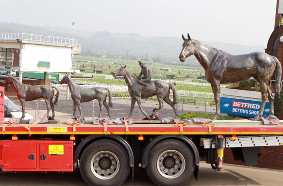 The four statues on the move from Cheltenham.