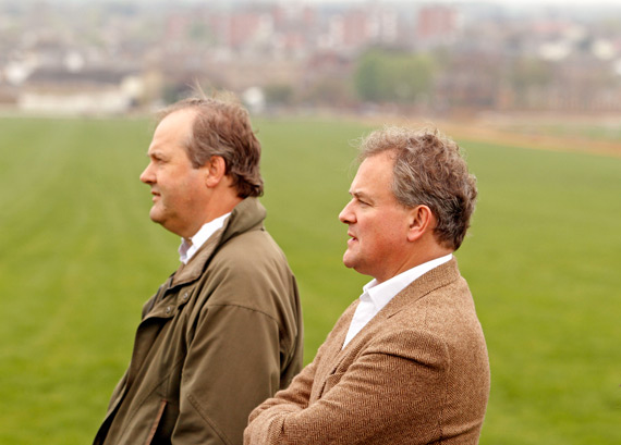 Hugh Bonneville and Harry Herbert, Managing Director of Highclere Thoroughbred Racing, watching Gothic work on the gallops in Newmarket.