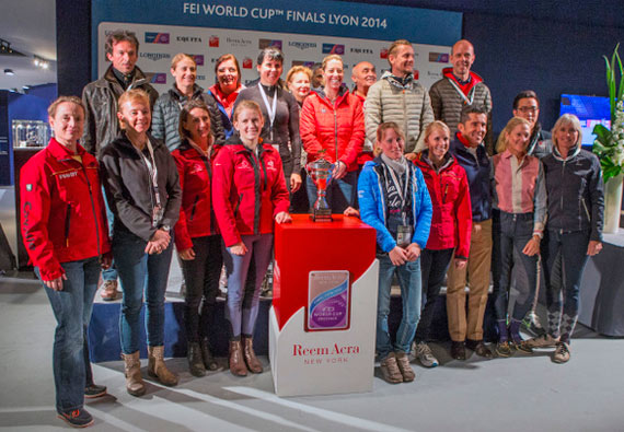 All 18 riders gathered for the draw for the first leg of the Reem Acra FEI World Cup™ Dressage Final 2013/2014 which begins tomorrow in Lyon, France with the Grand Prix. Standing to the left of the trophy is defending champion Helen Langehanenberg from Germany.