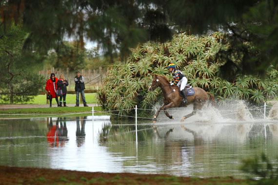 Megan Jones powers through the ornamental lake on KP Allofasudden at the Melbourne International Horse Trials.