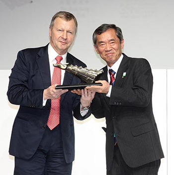 New Chairman Mr Winfried Engelbrecht-Bresges presents a souvenir to thank Dr Koji Sato for his five years as Chairman of the Asian Racing Federation.