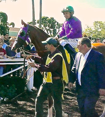 California Chrome at the 2014 San Felipe Derby with Victor Espinoza on board and trainer Alan Sherman at right.