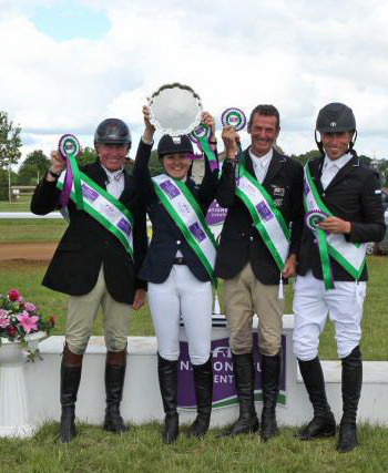 New Zealand celebrates after their win at Houghton International, from left, Craig Nicolai, Lizzie Brown, Mark Todd and Tim Price.