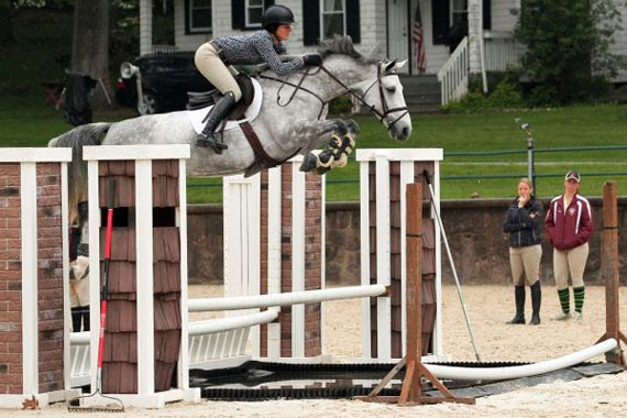 Maggie McAlary completes the water jump using impulsion and anticipation.