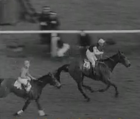Michael Scudamore and Oxo winning the 1959 Grand National.